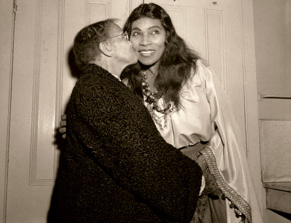 Marian Anderson's mother, Anna Anderson, kisses her after the performance of Verdi's A Masked Ball at the Metropolitan Opera on Jan. 7, 1955. Marian Anderson's father passed away when she was young. She dropped out of high school to help support her mother and family before returning several years later and graduating at 24.