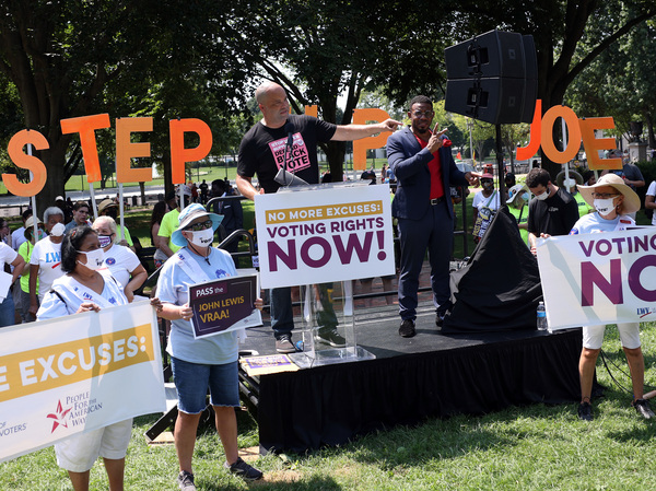 Civil rights leader Ben Jealous speaks at a voting rights rally outside the White House on Aug. 24 in Washington, D.C. Marches across the country are planned for Saturday.