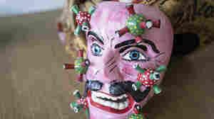 PHOTOS: Mexican Masks Portray COVID As A Tiger, A Devil, A Blue-Eyed Man
