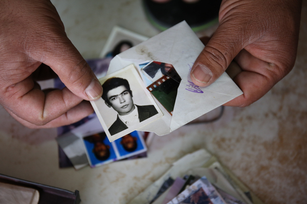 Uncollected or duplicate photographs found in boxes and drawers in backrooms of Kabul's photo studios.