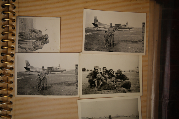 An Afghan photo studio owner and box camera photographer keeps an album with pictures he made during his years in Afghanistan's military.