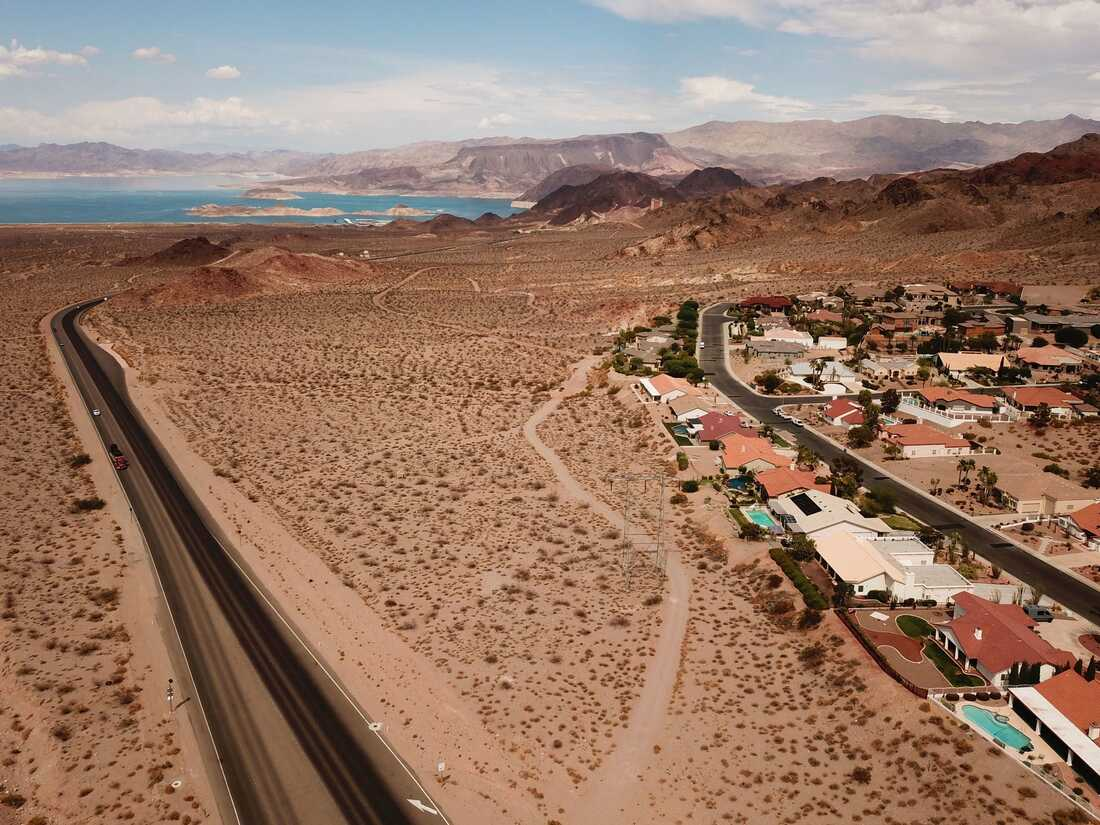 An aerial image shows homes in Bolder City, right, and Lake Mead on the Colorado River, left, during low water levels due to the western drought on July 20, 2021 from Boulder City, Nevada.