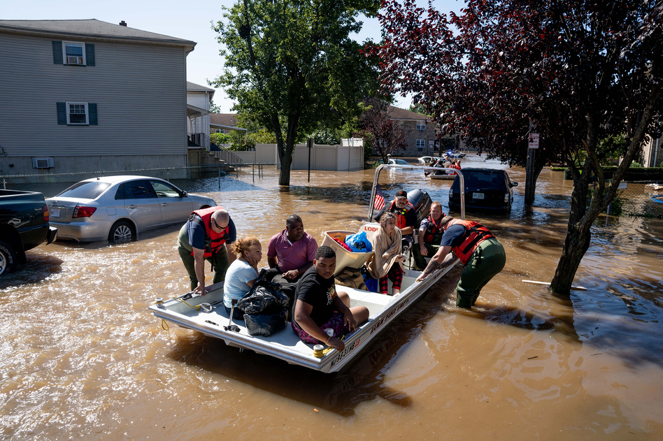 Members of the fire department in Lodi, N.J., perform water rescues Thursday on residents trapped after torrential rains from the remnants of Hurricane Ida. (Michael Candelori/NurPhoto/Reuters)