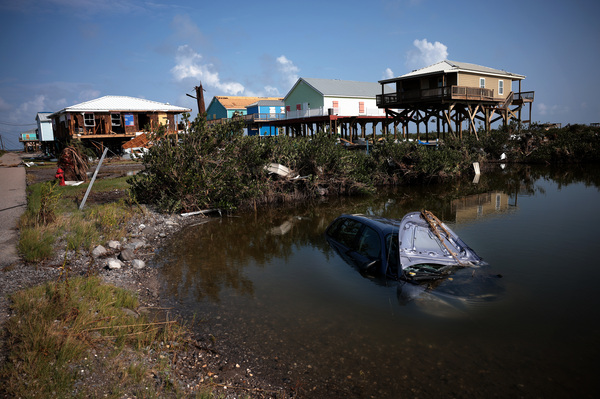 In Grand Isle, La., Ida, which struck as a hurricane over last weekend, destroyed homes and left an automobile submerged on Thursday.
