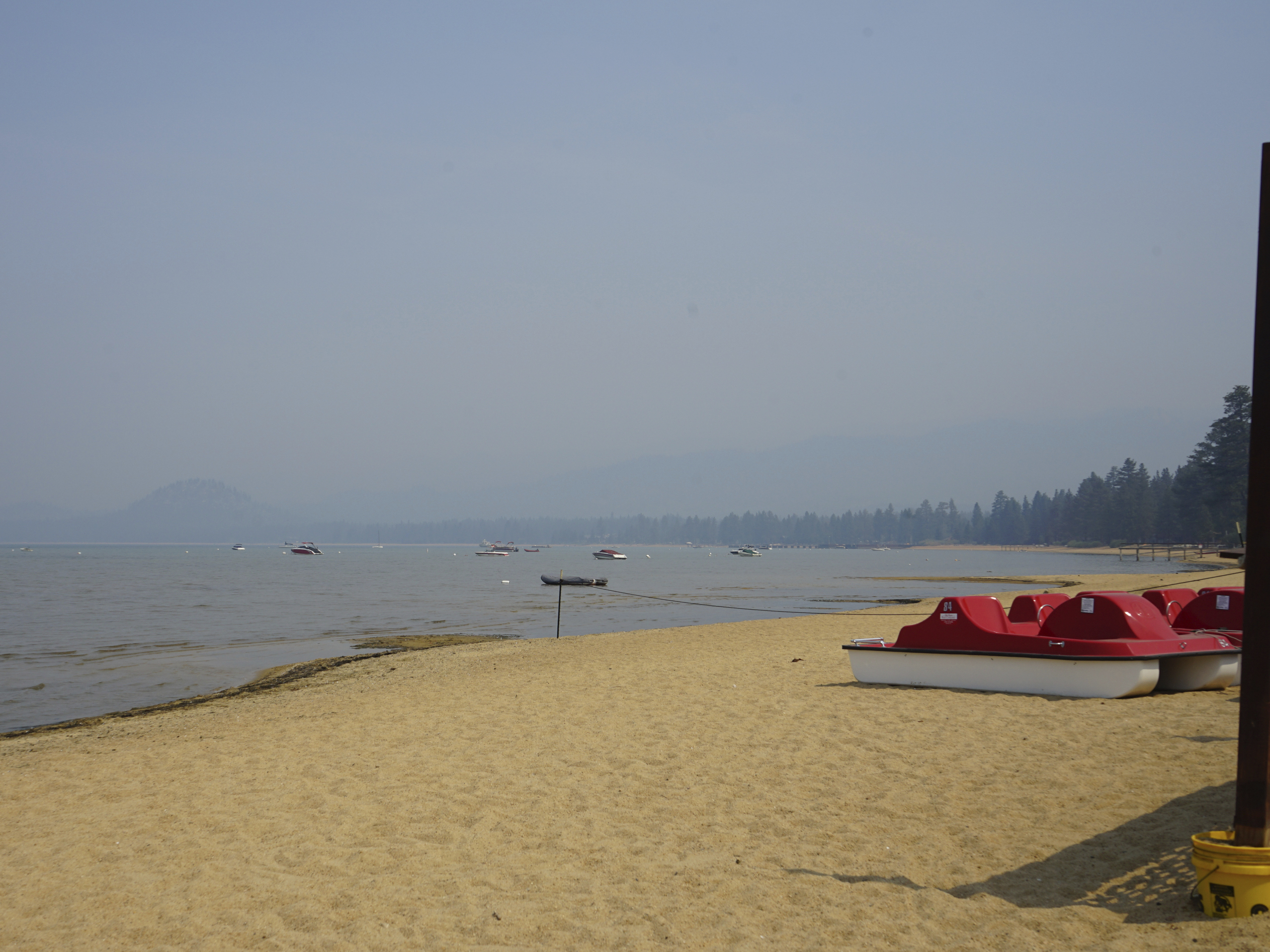 Smoke shrouds parts of Lake Tahoe visible from the Ski Run Marina in downtown South Lake Tahoe on Monday.