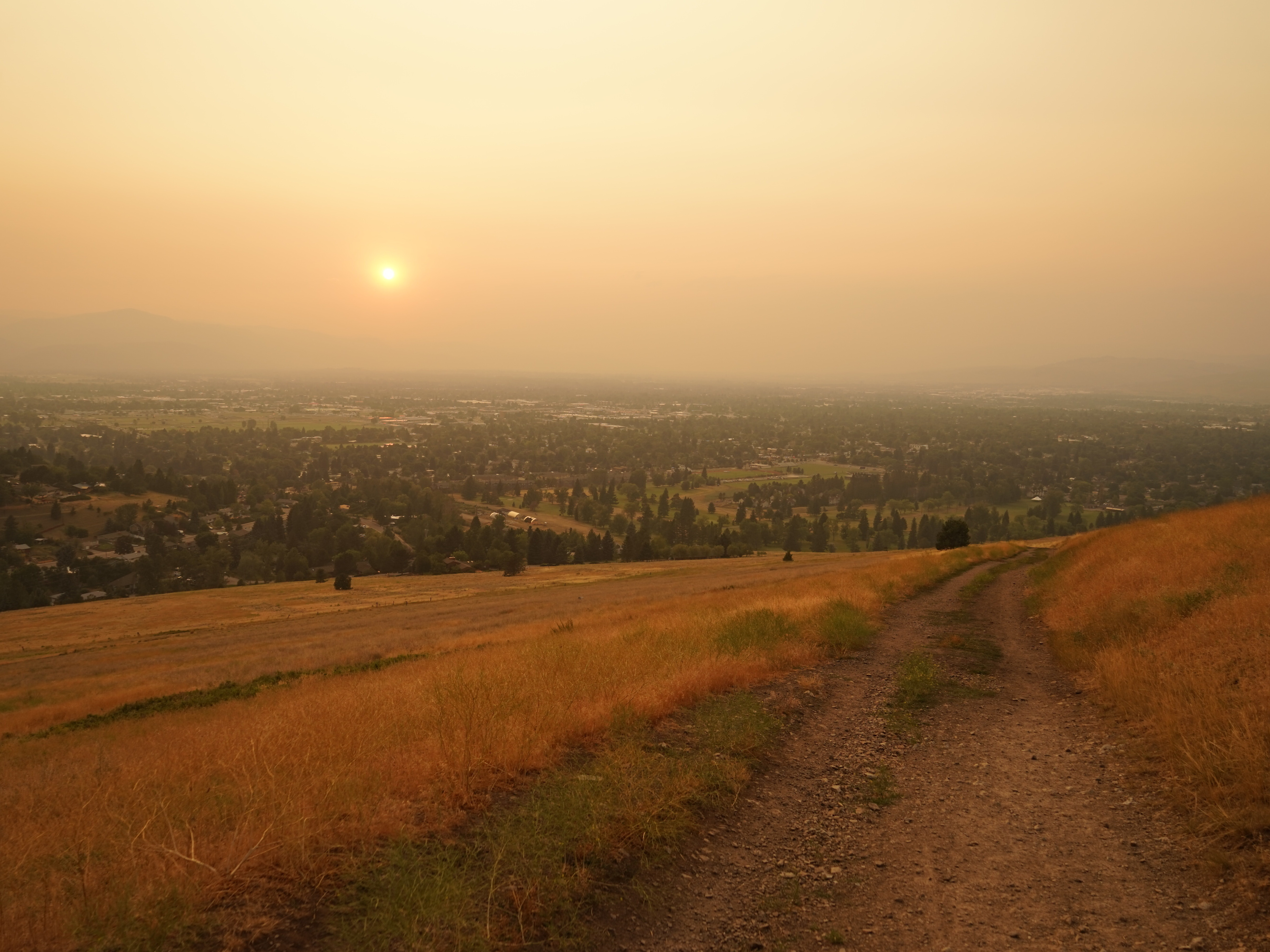 Wildfire smoke blankets Missoula, Mont., at the end of a hot summer day. The mountain town has been inundated with smoke for weeks this summer.