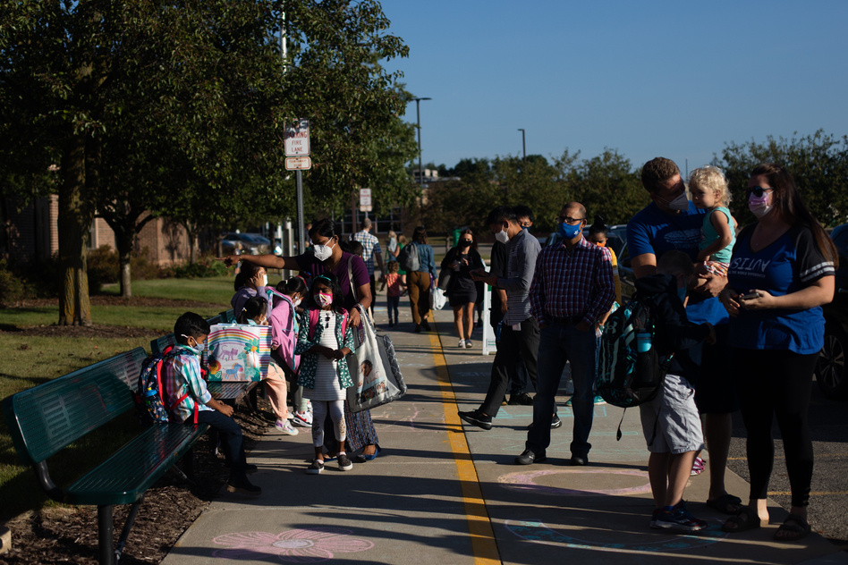 Parents drop their children off for the first day of school in Novi, Mich., on Tuesday. (Emily Elconin/Bloomberg/Getty Images)