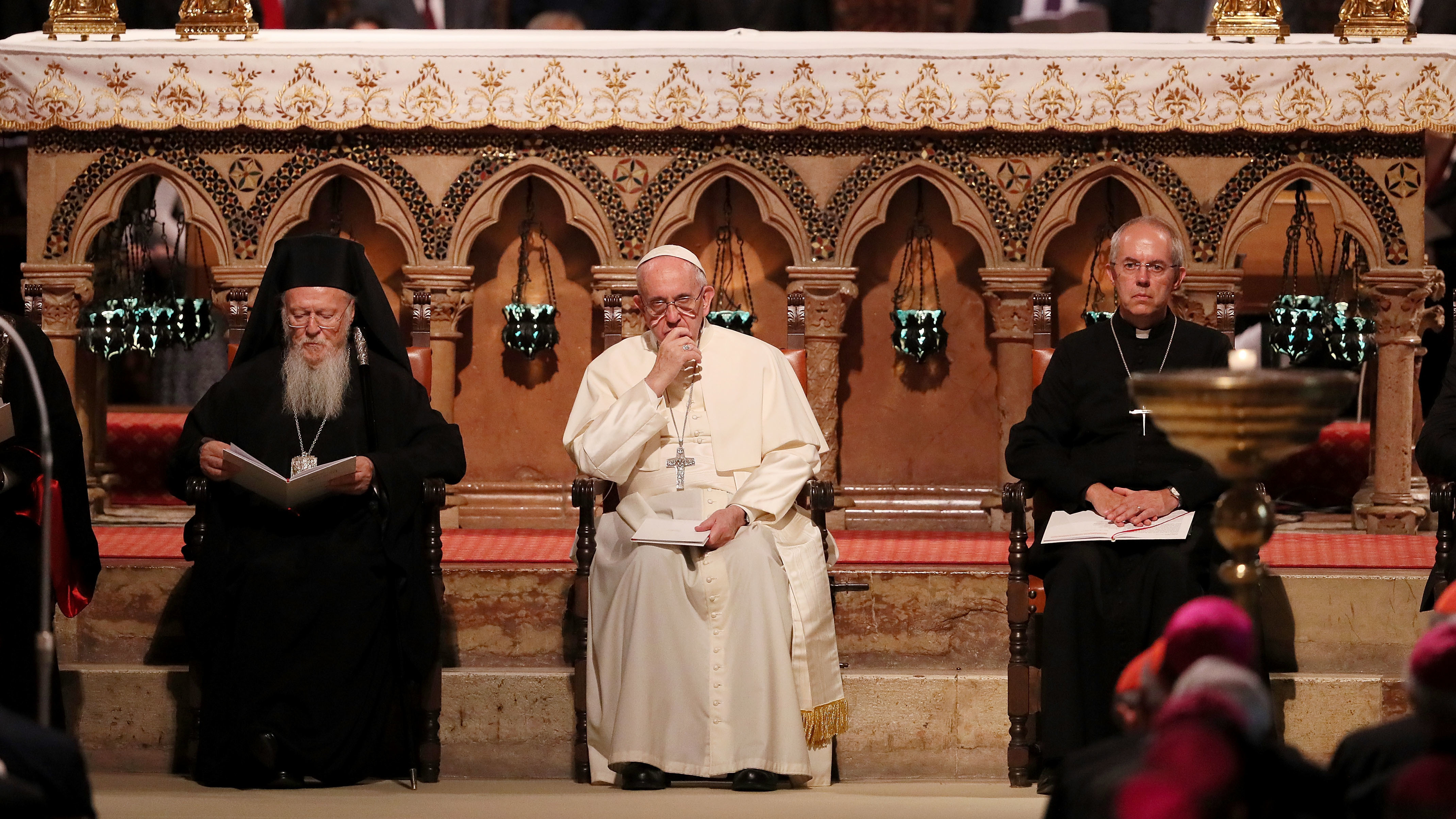 Pope Francis, Archbishop of Canterbury Justin Portal Welby and Archbishop of Constantinople and Ecumenical Patriarch Bartholomew, shown at a meeting of prayer in the Basilica of St. Francis in 2016, are asking for climate action.