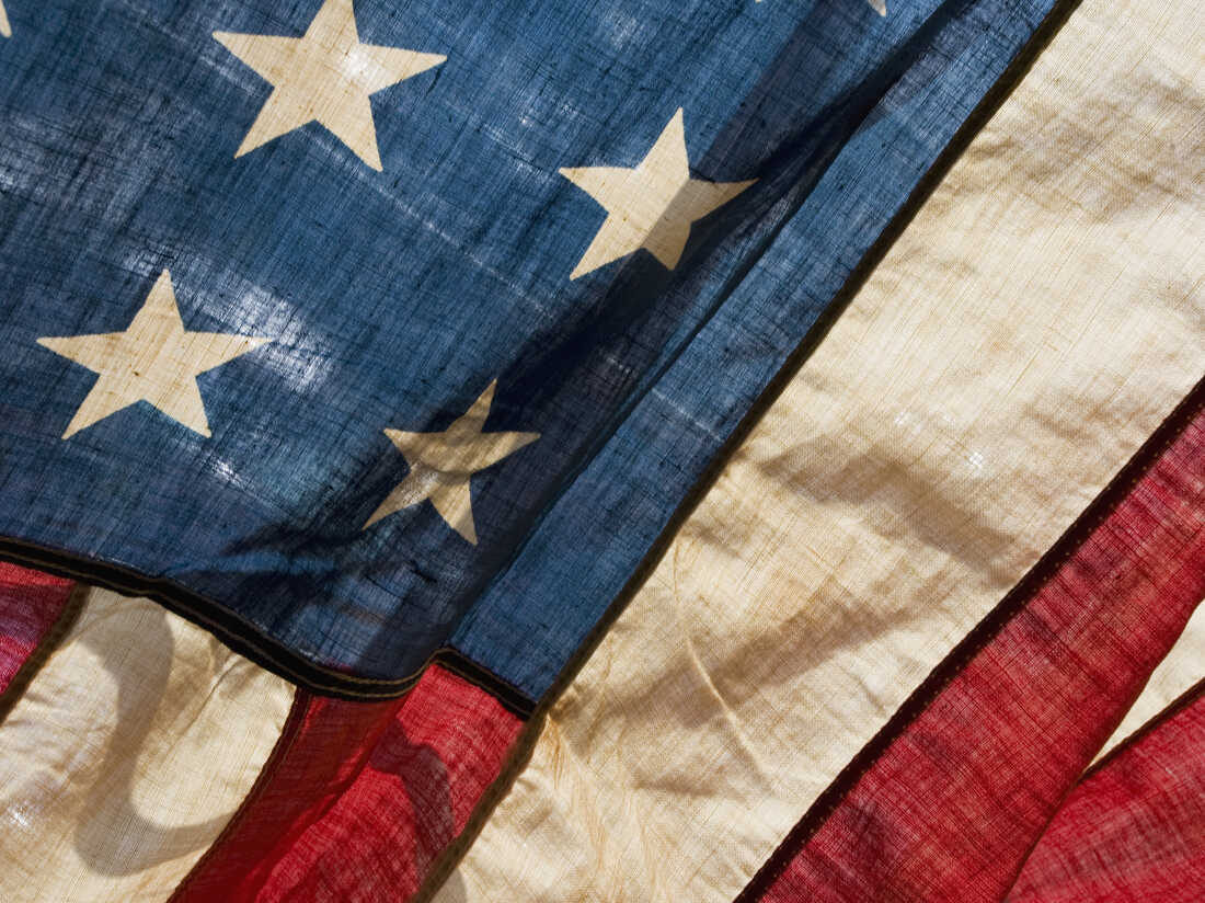 Close-up photo of old American flag.