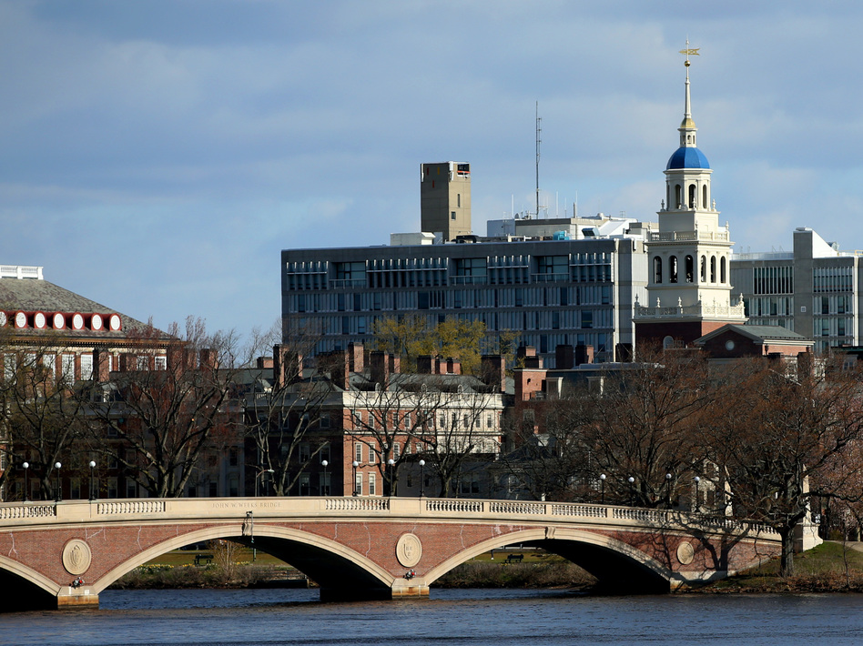Harvard University President Lawrence Bacow said Thursday that the university will move to end its investments in fossil fuel companies, though stopped short of using the word