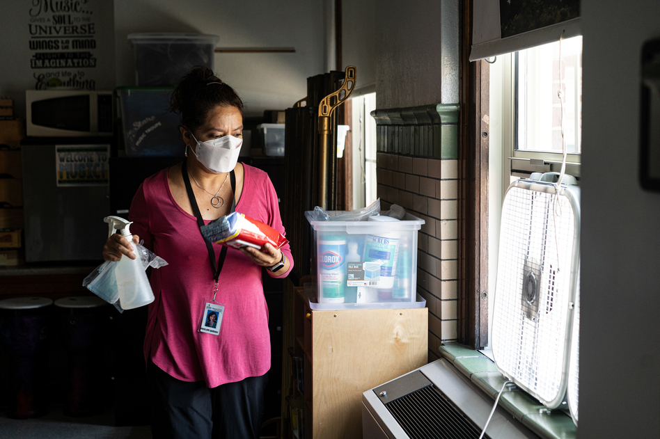 Before classes begin for the day, elementary music teacher Penelope Quesada gathers her most commonly used cleaning supplies and places them around the classroom in places of convenience.