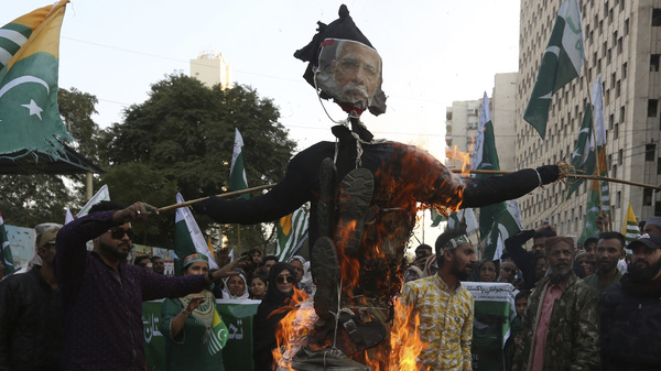 FILE - In this Feb. 5, 2020, file photo, protesters in Karachi, Pakistan burn an effigy of Indian prime minister during a rally to express solidarity with Indian Kashmiris struggling for their independence.