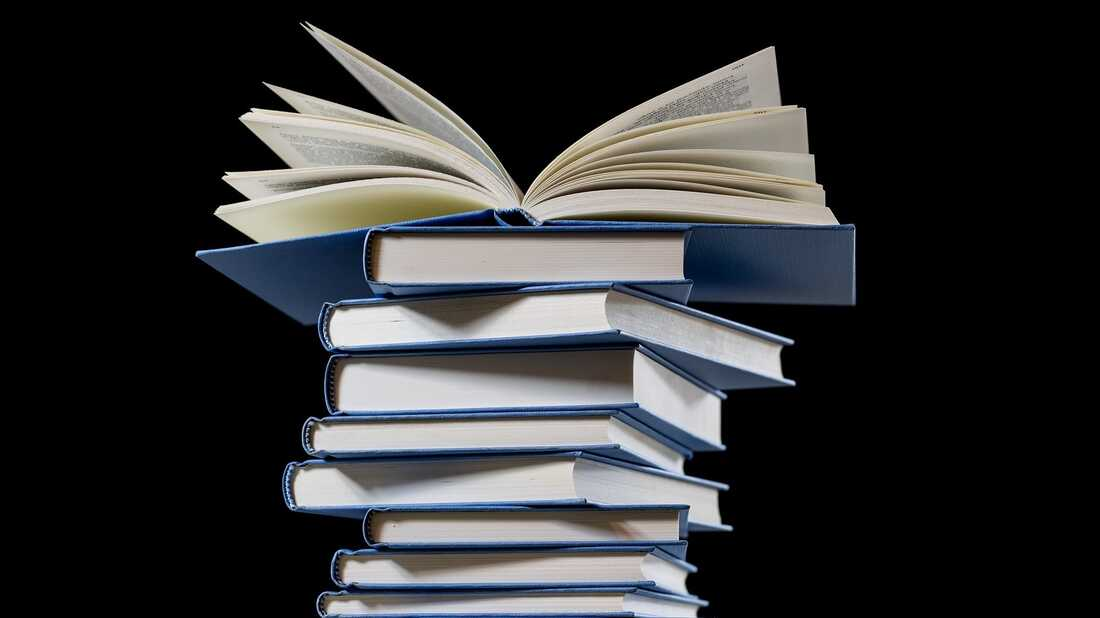 A stack of books on a black background.