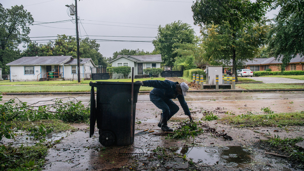 Dallas Baines, 77, clears fallen tree branches Tuesday after Tropical Storm Nicholas moved through the Houston area. The storm will likely slow down as it heads to Louisiana, where parts of the state continue to cope with Hurricane Ida's aftereffects.