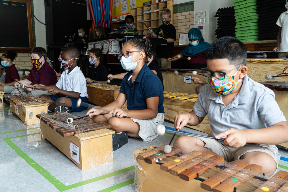 Students in Quesada's third grade music class all get the opportunity to play a xylophone. Quesada does what she can to keep the instruments clean. Her xylophones are expensive and wiping them down regularly could ruin them, so instead she spends her morning wrapping them in plastic wrap.