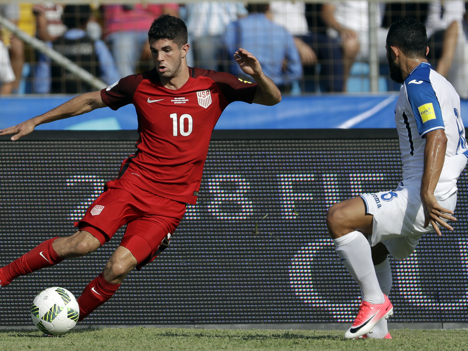 U.S. soccer player Christian Pulisic controls the ball during a World Cup qualifying match against Honduras in San Pedro Sula, Honduras, in September 2017.