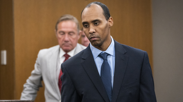 Former Minneapolis police officer Mohamed Noor walks to the podium to be sentenced in Minneapolis on June 7, 2019. The Minnesota Supreme Court on Wednesday reversed his third-degree murder conviction, saying the charge doesn