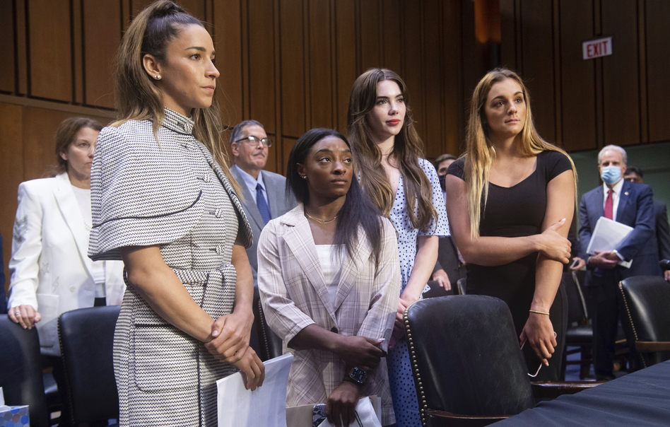 Gymnasts (from left) Aly Raisman, Simone Biles, McKayla Maroney and Maggie Nichols leave after testifying Wednesday at a Senate Judiciary Committee hearing on the FBI's handling of the Larry Nassar investigation. Nassar was charged in 2016 with federal child pornography offenses and sexual abuse charges in Michigan and is now serving decades in prison. (Saul Loeb/Pool via AP)