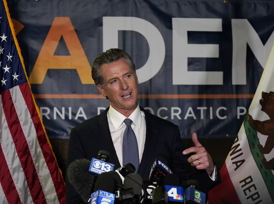 California Gov. Gavin Newsom addresses reporters Tuesday in Sacramento after beating back the recall effort that aimed to remove him from office.