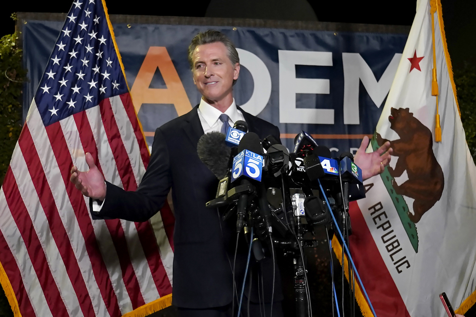 California Gov. Gavin Newsom addresses reporters Tuesday at the John L. Burton California Democratic Party headquarters in Sacramento after beating back the recall attempt that aimed to remove him from office. (Rich Pedroncelli/AP)