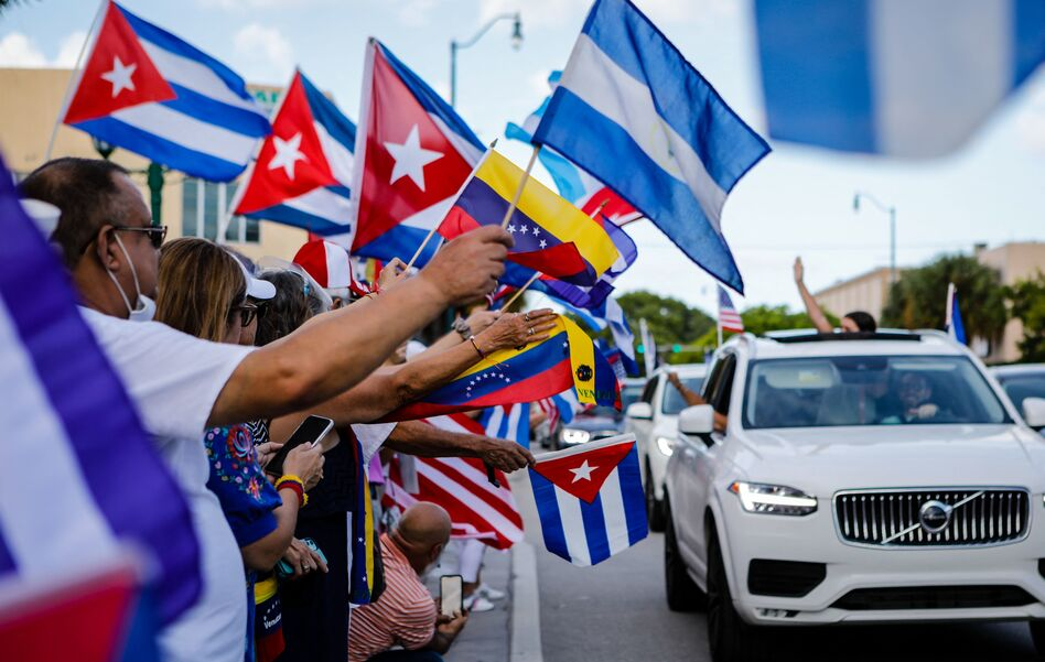 People hold Cuban, Venezuelan and Nicaraguan flags during a protest showing support for Cubans demonstrating against their government in Miami on July 18. The US. Latino population has grown significantly in the last decade.