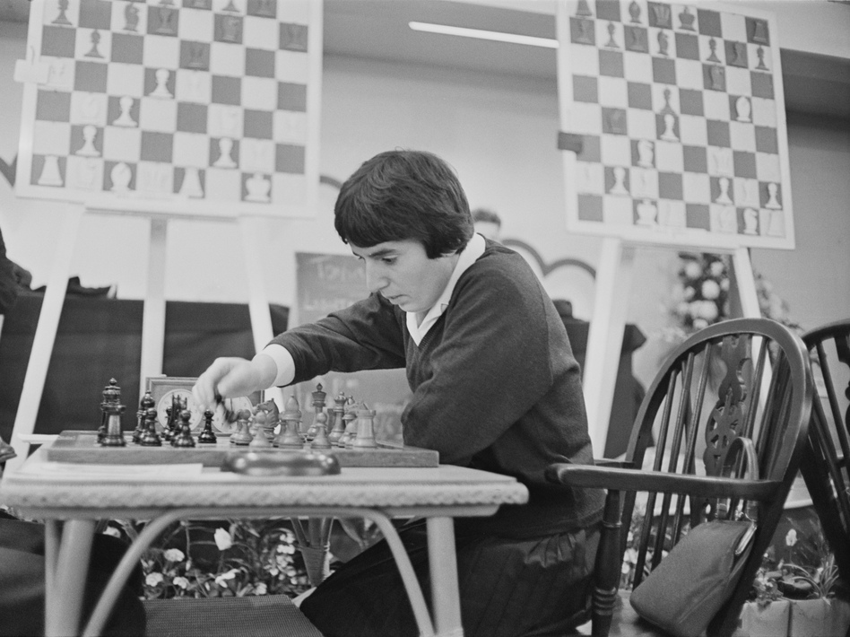 Georgian chess champion Nona Gaprindashvili plays at the International Chess Congress in London on Dec. 30, 1964. She is suing Netflix for defamation and invasion of privacy over its series <em>The Queen's Gambit.</em> (Stanley Sherman/Getty Images)