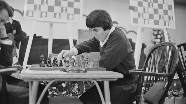 Georgian chess champion Nona Gaprindashvili plays at the International Chess Congress in London on Dec. 30, 1964. She is suing Netflix for defamation and invasion of privacy over its series The Queen