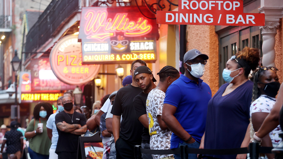 People queue to enter a restaurant in New Orleans' French Quarter in early August. (Mario Tama/Getty Images)