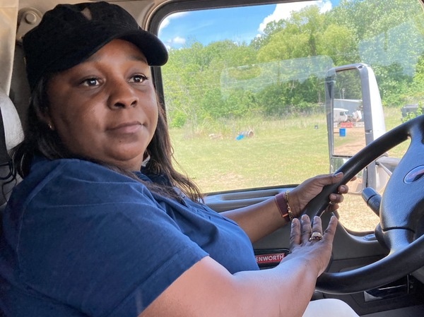Williams demonstrates how to drive a truck at the DSC Training Academy on June 29. The teaching includes explaining the two types of airhorns used by trucks.