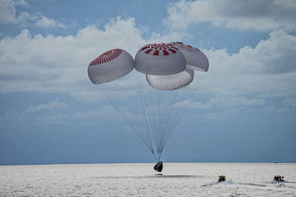 In this image provided by SpaceX, a capsule carrying the all-amateur Inspiration4 crew parachutes into the Atlantic Ocean off the Florida coast on Saturday, Sept. 18, 2021. (AP)
