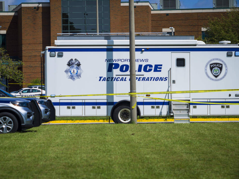 Police respond to the scene of a shooting at Heritage High School in Newport News, Va., on Sept. 20, 2021. (John C. Clark/AP)