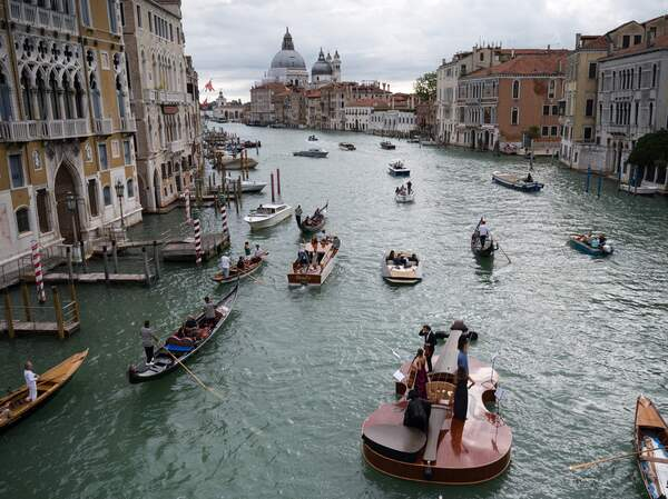 """""""Noah's Violin"""", a giant floating violin by Venetian sculptor Livio De Marchi, journeyed through Venice's Grand Canal on Saturday. De Marchi, who has sent many wooden works into the water, came up with the idea during last year's pandemic lockdown."""