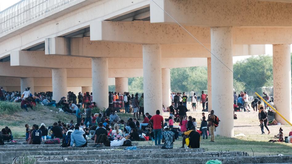 Migrants at the Rio Grande near the port of entry in Del Rio, Texas, on Saturday. (Charlie C. Peebles/Anadolu Agency via Getty Images)