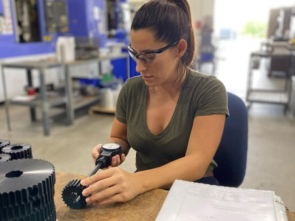 Nicole Wolter at work at her factory in Wauconda, Ill., which makes components for industrial machines. Wolter's company is straining to meet demand as her own suppliers struggle with short staffing. (HM Manufacturing)