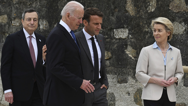 In this Friday, June 11, 2021 file photo, from left, Italian Prime Minister Mario Draghi, U.S. President Joe Biden, French President Emmanuel Macron and European Commission President Ursula von der Leyen walk together during the G7 Summit, in Carbis Bay, Cornwall, England.