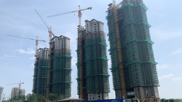 Half-finished apartment towers are part of Evergrande