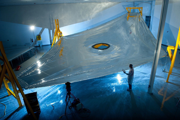 A high-tech, five-layer sunshield helps the telescope stay at negative 370 degrees Fahrenheit, so it can detect heat signals from very distant objects.