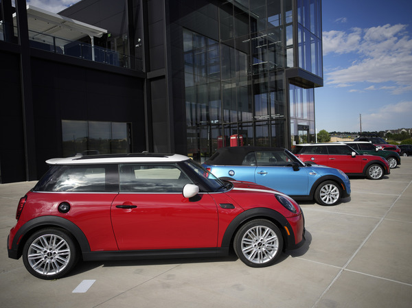 A small assortment of unsold 2022 models sits outside a Mini dealership in Highlands Ranch, Colo., on Sept. 12. Being flexible and staying patient are among the things to keep in mind if you are shopping for a car.