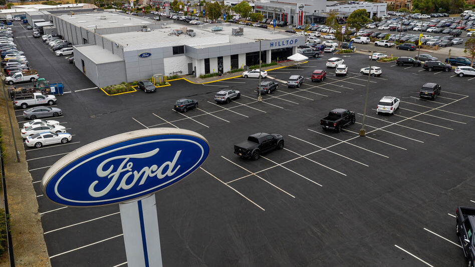 Vehicles sit in a nearly empty lot at a car dealership in Richmond, Calif., on July 1. The global semiconductor shortage has hobbled auto production worldwide, making it difficult to find a car to buy. (David Paul Morris/Bloomberg via Getty Images)