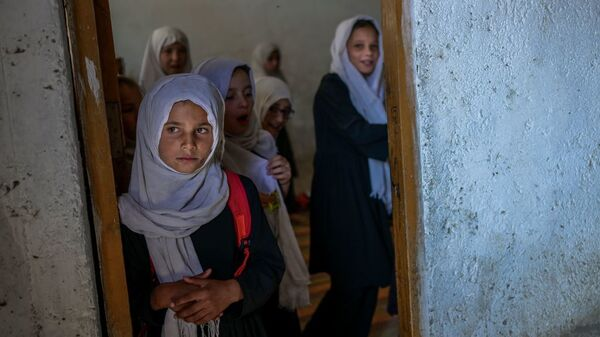 Girls gather at a gender-segregated school in Kabul on Sept. 15. When older secondary students returned to classes, female students were told to wait.