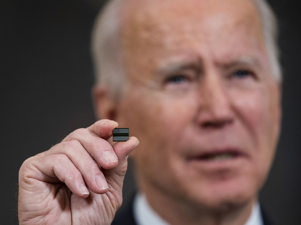 President Biden holds a chip during remarks before signing an executive order on the economy  on Feb. 24. The Biden administration is taking steps to try to improve the supply of semiconductors in the United States.