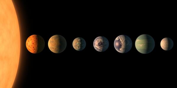 This artist's impression shows the TRAPPIST-1 star with its seven Earth-sized planets. The new telescope will be able to probe their atmospheres, if they have air.