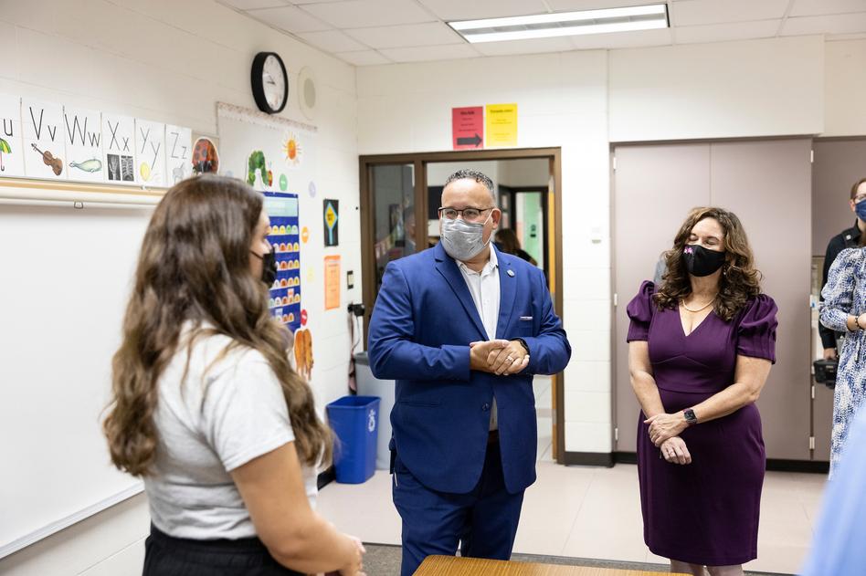Cardona, center, and U.S Deputy Secretary of Education Cindy Marten, right, talk with staff at Locust Lane Elementary.
