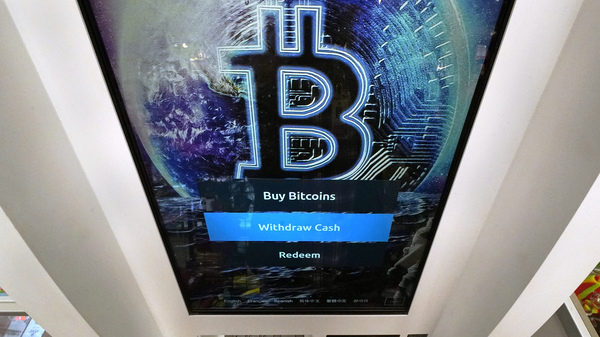 The Bitcoin logo appears on the display screen of a cryptocurrency ATM at the Smoker