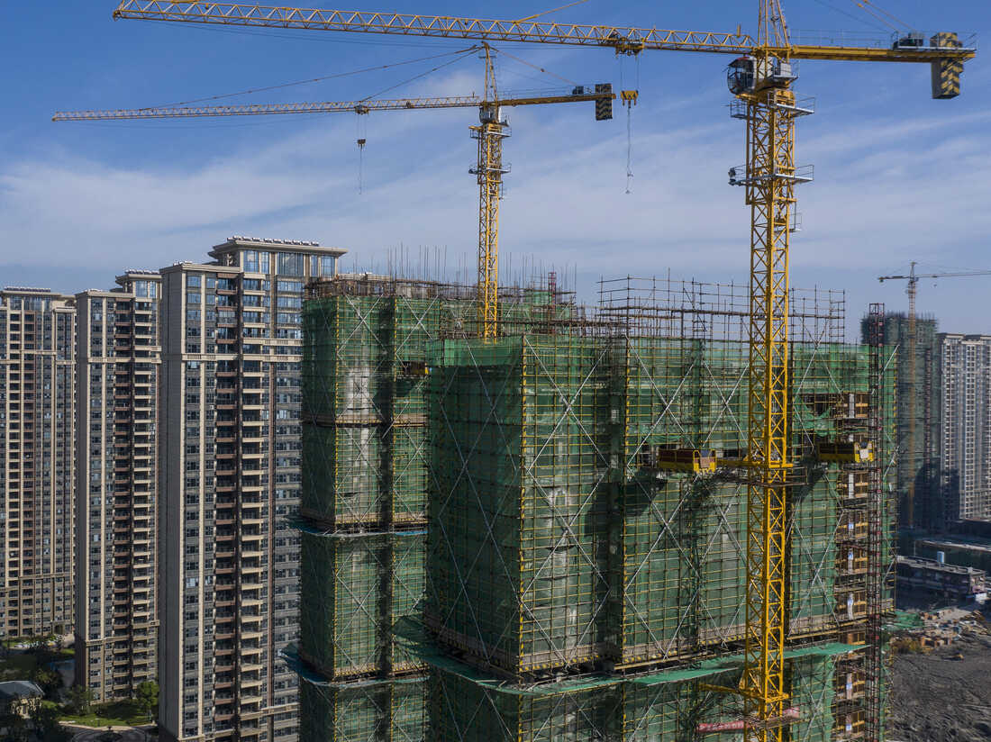 High-rise apartment buildings at China Evergrande Group's under-construction Riverside Palace development in Taicang, Jiangsu province, China, on Friday, Sept. 24, 2021. Photographer: Qilai Shen/Bloomberg via Getty Images