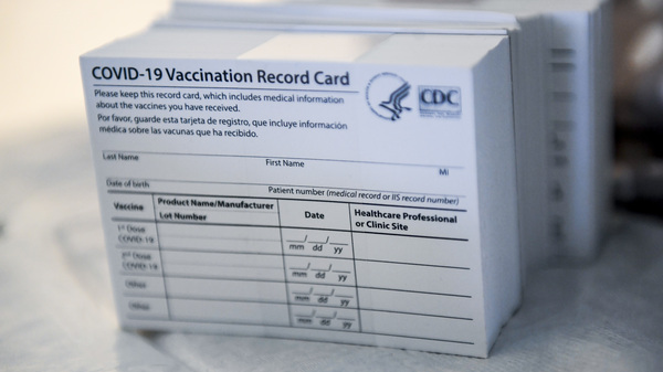 A stack of COVID-19 vaccination record cards from the Centers for Disease Control and Prevention. They provide proof that you