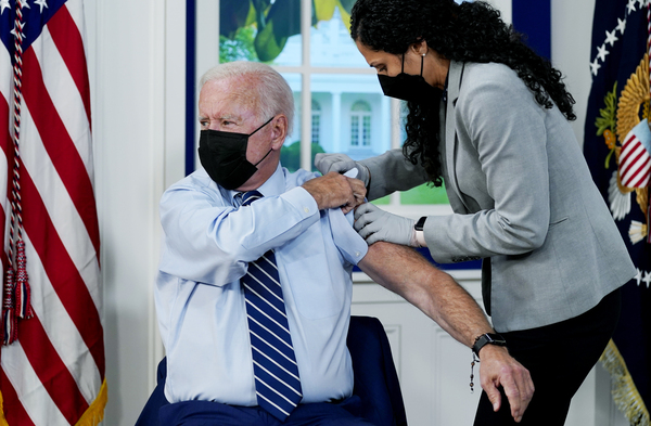 President Joe Biden receives a COVID-19 booster shot during an event at the White House campus on Sept. 27.