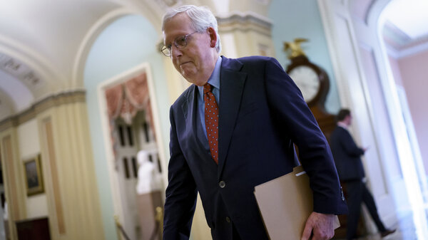 Senate Minority Leader Mitch McConnell, R-Ky., walks to the chamber Monday for a test vote on a government spending bill.