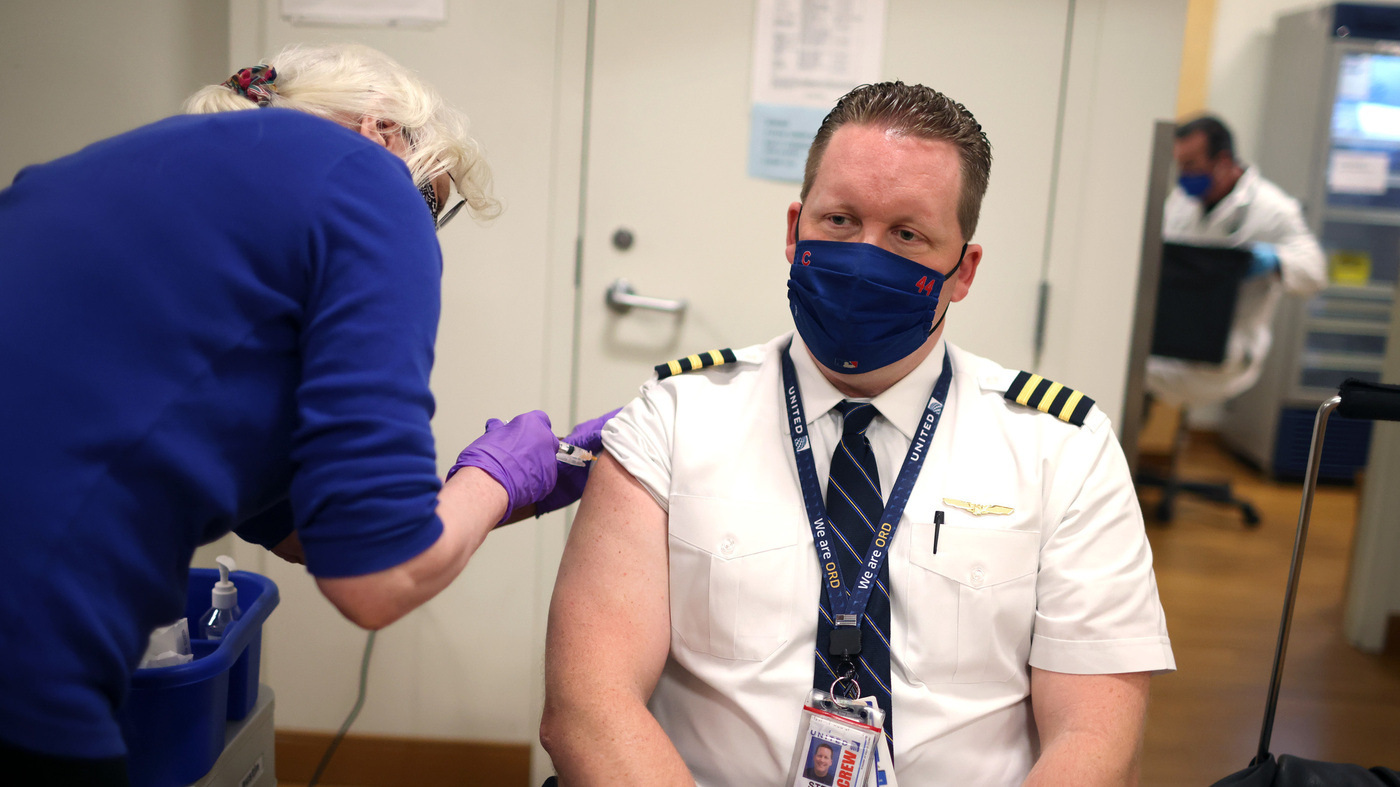 United Airlines Says Almost All Its Workers Are Vaccinated; Some Others May Be Fired – NPR