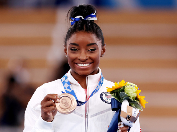 Simone Biles poses with the bronze medal during the Women's Balance Beam Final medal ceremony on day eleven of the Tokyo 2020 Olympic Games on August 03, 2021.